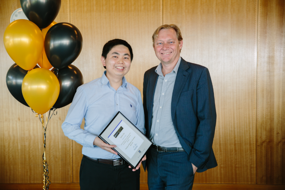 Kelvin Tan accepts award from BEL Executive Dean Professor Andrew Griffiths